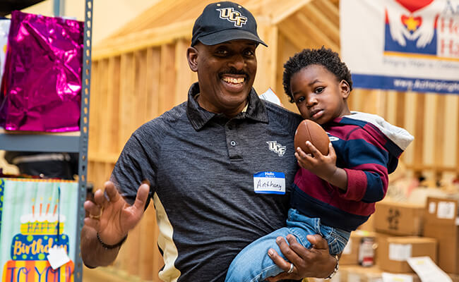 UCF Knight and child attend UCF event