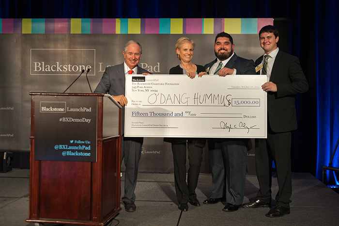 UCF student-entrepreneurs Jesse Wolfe (second from right) and Ryan Atkins (right) won the $15,000, second-place award for  their venture, O'Dang Hummus, at the Blackstone Charitable Foundation's Demo Day.