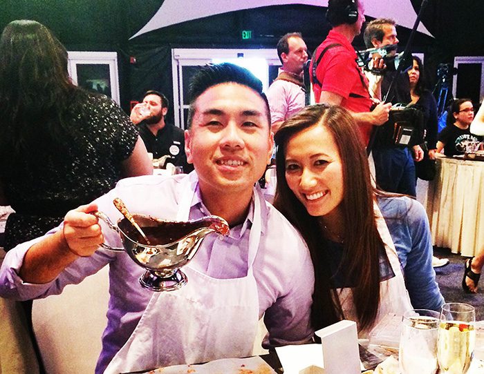 """Ricky Ly, '08, and wife May (Wong), '07, enjoy culinary delights at Epcot's International Food & Wine Festival for ABC's """"The Chew."""""""