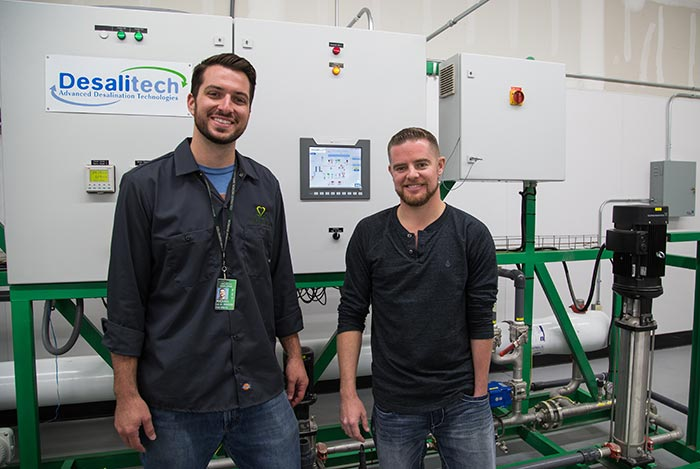 Michael Williamson, '07 (left), purchased a water treatment system from his best friend, Michael Boyd, '05,  to save and reuse water in his company's new 80,000-square-foot, hydroponic, medical marijuana cultivation center.